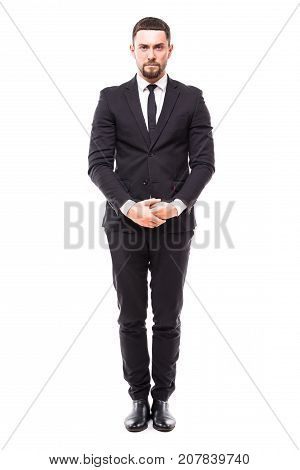 Confidence And Charisma. Full Length Of Smiling Young Bearded Man In Formalwear Keeping Hands Crosse