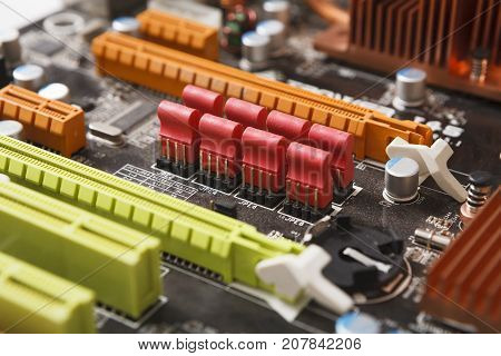 Computer motherboard close-up. Inside of disassembled laptop, microprocessor components. Electronic upgrade, repair shop concept