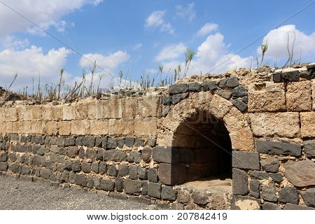 The ancient wall is built of natural stones and cobblestones