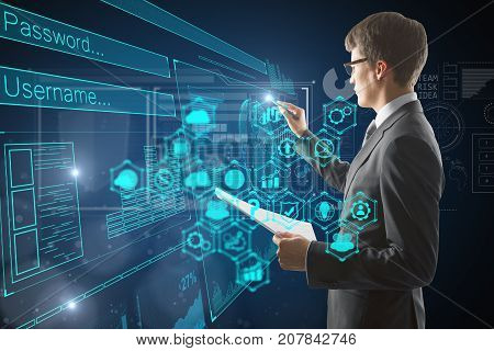 Side view of young businessman with document in hand drawing abstract digital business interface on dark blue background. Technology concept. Double exposure