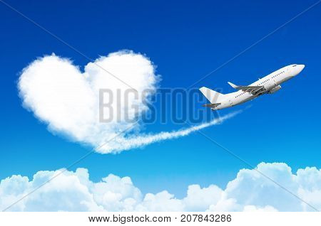 Airplane In The Blue Sky With Clouds, Left A Trace In The Form Of A Cloud Of The Heart.