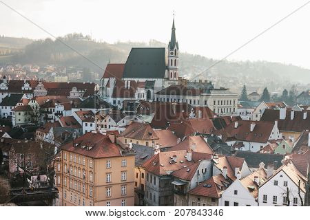 City view of the houses and the Church of St. Vitus in Cesky Krumlov in the Czech Republic. The church is one of the main sights of the town. European town.