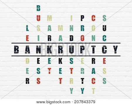 Business concept: Painted black word Bankruptcy in solving Crossword Puzzle
