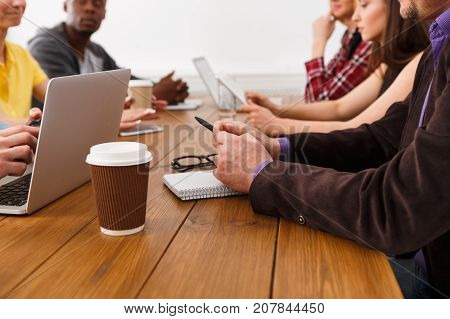 Business corporate meeting of unrecognizable successful team, copy space. Office discussion, communication with partners, modern technologies concept