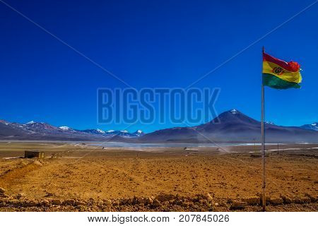 View on Bolivian Flag by the border to Chile in the Andes