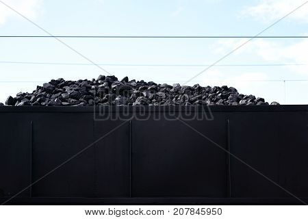 The loading area of an old steam locomotive with coal for heating the steam boiler.