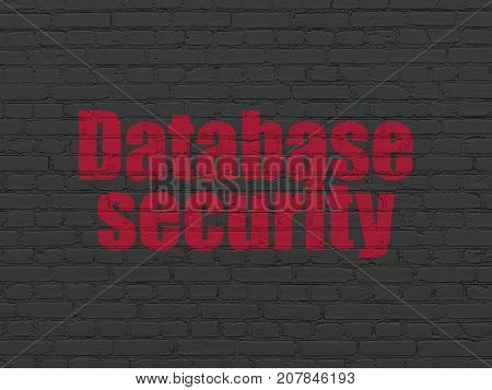 Software concept: Painted red text Database Security on Black Brick wall background