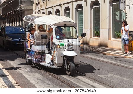White Tuk Tuk Taxi Cab With Tourists
