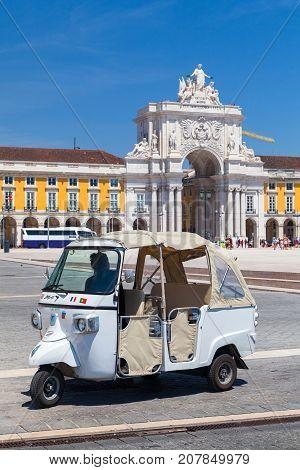 White Tuk Tuk Taxi Cab With Driver, Lisbon