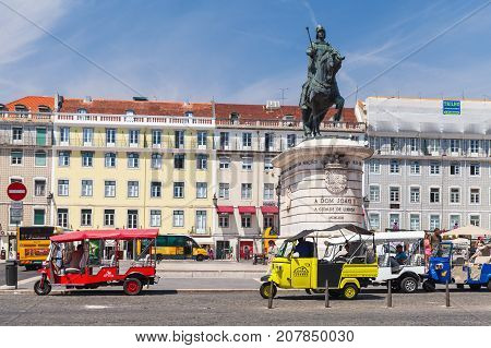 Tuk Tuk Of Lisbon Stand On A City Square