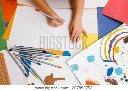 Early children education. Artistic child. Unrecognizable creative kid top view, colorful drawing process, creativity concept