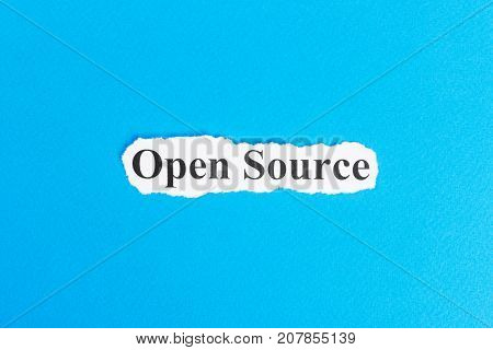Open source text on paper. Word Open source on torn paper. Concept Image.