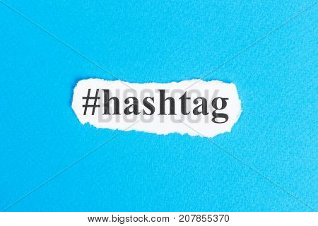 Hashtag text on paper. Word Hashtag on torn paper. Concept Image.