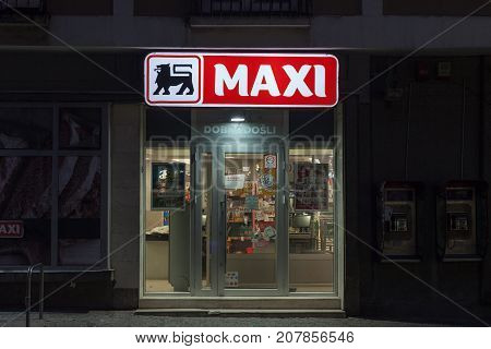BELGRADE SERBIA - OCTOBER 10 2017: Entrance of a Maxi Supermarket in the evening. Belonging to the Belgian group Delhaize Maxi Supermarkets is the leader in mass market retailing in Serbia