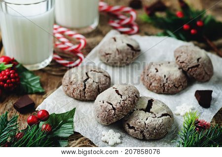 Chocolate Crinkle cookies for Christmas on a wood background