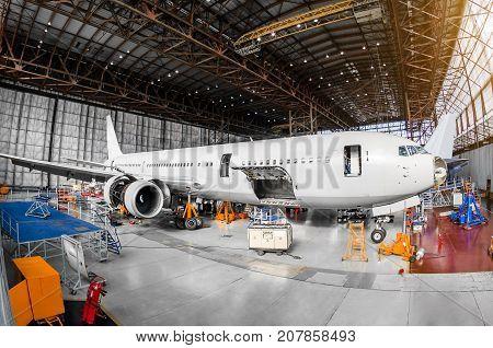 Large Passenger Aircraft In A Hangar On Service Maintenance.