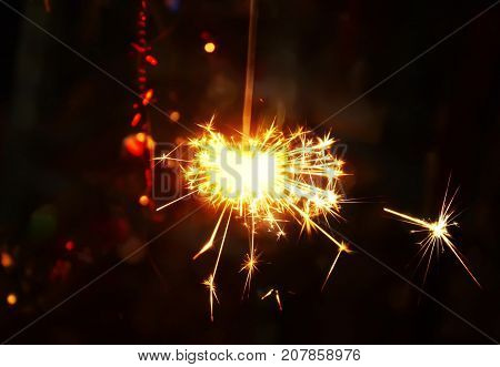 Bengali fire. Festive new year background with bright firework lights. poster