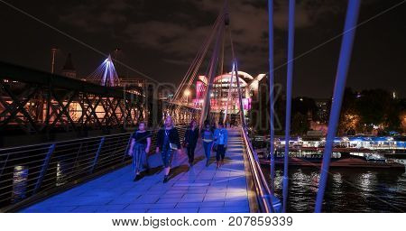London, UK. 29th September 2017. People are walking over the Hungerford footbridge over the River Thames in central London