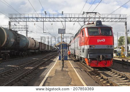 Danilov, Yaroslavl Region, Russia - July 25, 2017: Long-distance passenger train with electric locomotive CHS7-276 at the platform of the railway station Danilov Yaroslavl region