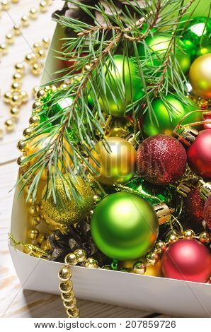 Box with red golden and green christmas balls. Christmas background.