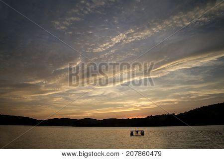 Interesting sunset with clouds over Squam Lake, New Hampshire