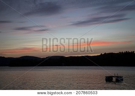 Sunset and colorful clouds over Squam Lake, New Hampshire