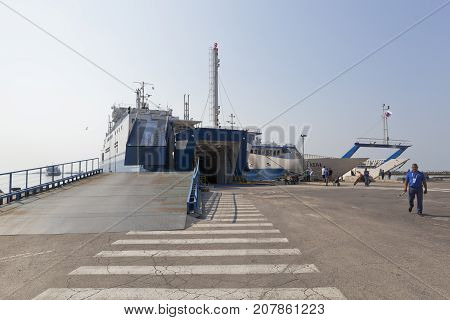 "Kerch, Republic of Crimea, Russia - July 23, 2017: Ferries ""Olympiada"" and ""Elena"" under loading in the port of Crimea"