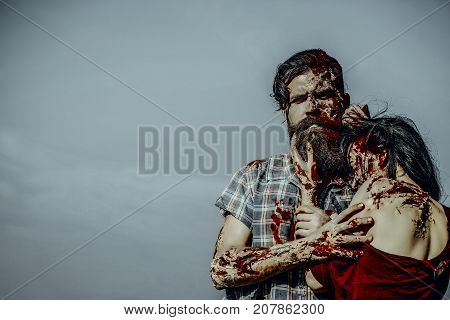 Halloween Zombie Couple Hugging On Blue Sky