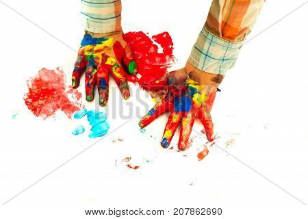 Child hands painted in colorful paints on white background. Arts and crafts. Handprint painting and drawing. Imagination creativity and freedom concept