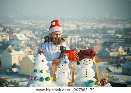 Man In Santa Hat And White Uniform On Winter Day