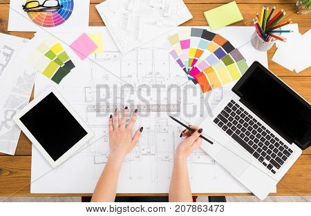 Interior designer working with color palette top view. Architect choosing colors for building decoration, blank tablet and laptop screen, mockup