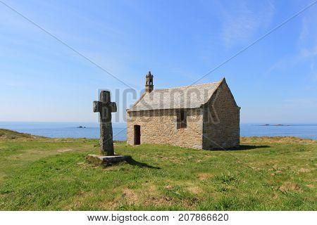 Saint Samson chapel and cross near the sea in Landunvez