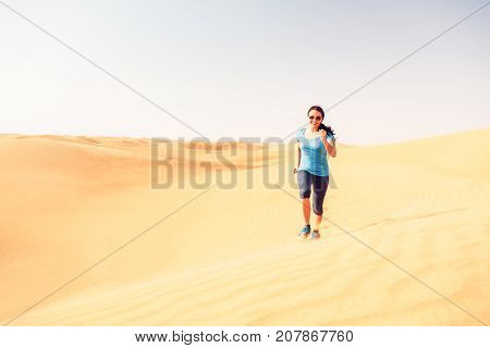 a runner jogging through the desert. Extreme sports concept.
