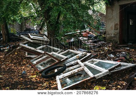 Large pile of rubbish, debris of building against the ruined house, can be used as consequences of war, earthquake, hurricane or other natural disaster
