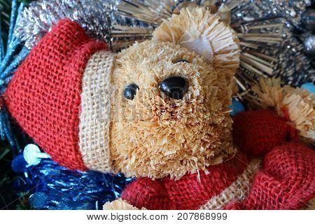 Santa Claus teddy bear silvery Christmas balls and blue tinsel on a Christmas wreath