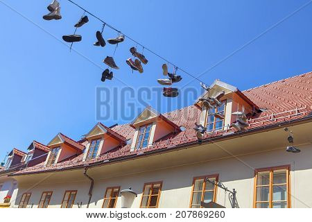 Shoes hanging on an cable against a blue sky