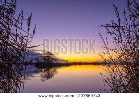 Blue and yellow Sunset over a Tranquil lake in Friesland Netherlands