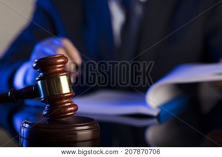 Man signing documents. Gavel. Law concept. Attorney concept.