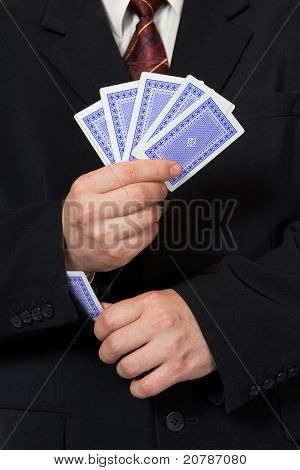 Hands And Playing Card In Sleeve
