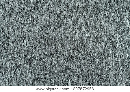 Gray artificial plain fur texture. Macro. Closeup