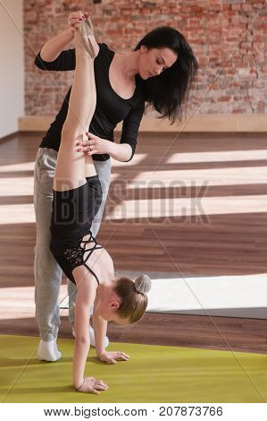 Young ballerina life. Important teaching. Sport for girls, rhythmic gymnastics with coach in dance class. Gym background, healthy teen lifestyle, femininity concept