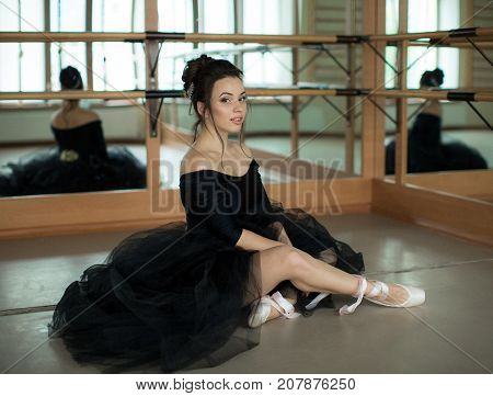 young ballerina is relaxing in class room