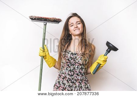 Emotional happy cleaning woman with mop and plunger