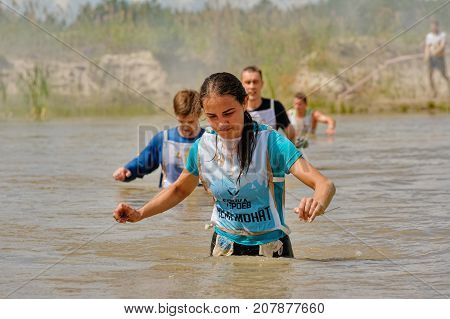 Tyumen, Russia - July 1, 2017: Race of Heroes project on the ground of the highest military and engineering school. Water stage. Teams running