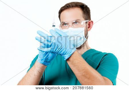 Doctor With Syringe Ready To Make Injection.