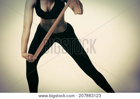 girl with elastic bands for sports on a light background.