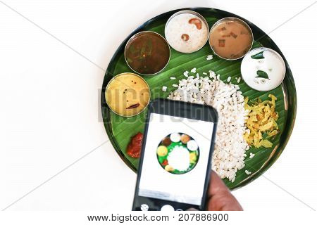 Indian thali meal - vegetarian food on banana leaf