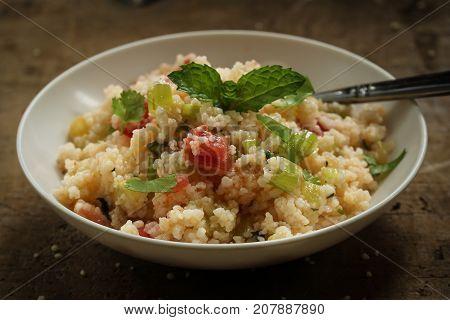 Tabbouleh Salad - Popular vegetarian Mediterranean dish made of fresh cucumbertomatoesparsley and coucous