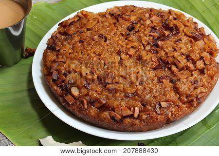 Kalathappam - Steamed Rice cake with jaggery coconut oil shallots from Malabar Kerala