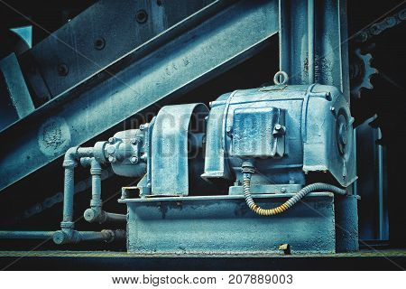 Detail of old steam train engine with rust. Steam-punk style background